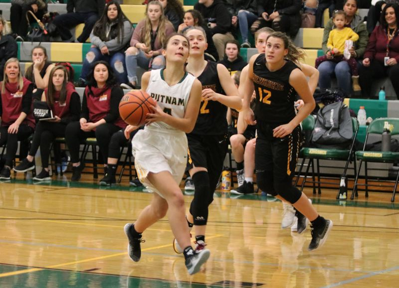 PAMPLIN MEDIA: JIM BESEDA - Putnam's Abigail Paul has an open lane to the basket during the first half of Tuesday's 76-51 home win over Milwaukie in the Northwest Oregon Conference opener for both teams at Putnam.