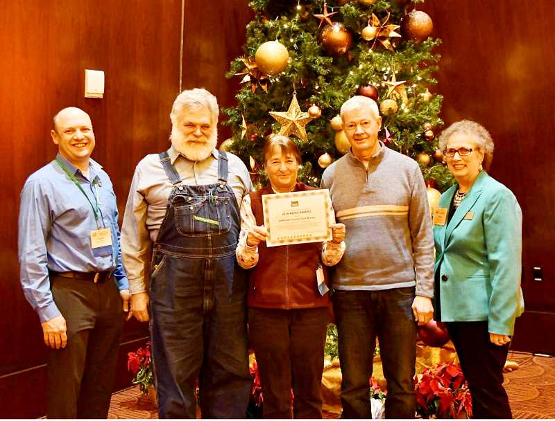 SUBMITTED PHOTO - At the award presentation are, from left, Logan Kerna, Ed Chotard, Mickey Killingsworth and Paul Clowers, with Oregon Farm Bureau President Sharon Waterman.