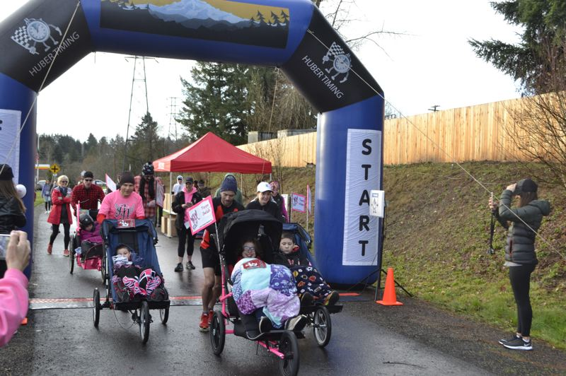 POST PHOTO: BRITTANY ALLEN - Dec. 30, 18 angel runners and five athlete riders from Ainsley's Angels raced in the Boring Resolution Relay.