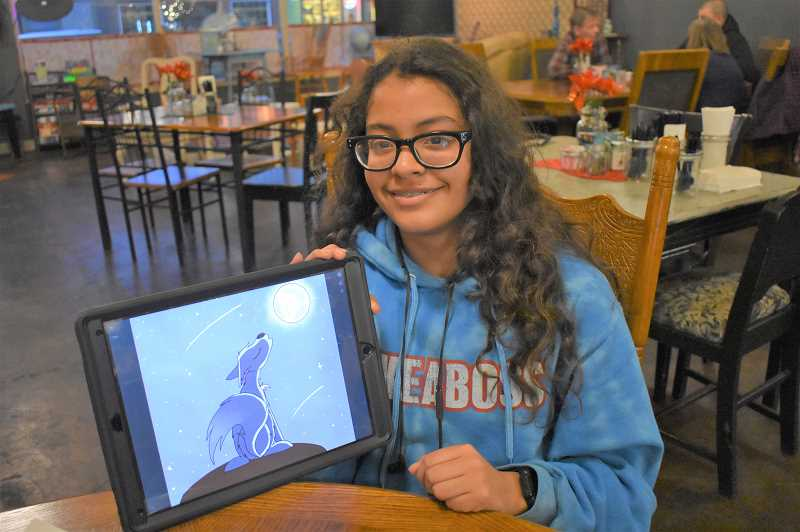ESTACADA NEWS PHOTO: EMILY LINDSTRAND - Estacada Middle School student Maria Roshto shows a sketch that she creates for 'The Wolfenoot Story' on her iPad.