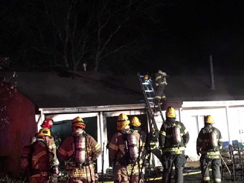 COURTESY HILLSBORO FIRE - Fire crews examine the damage after extinguishing a fire on Currin Drive Jan. 9.