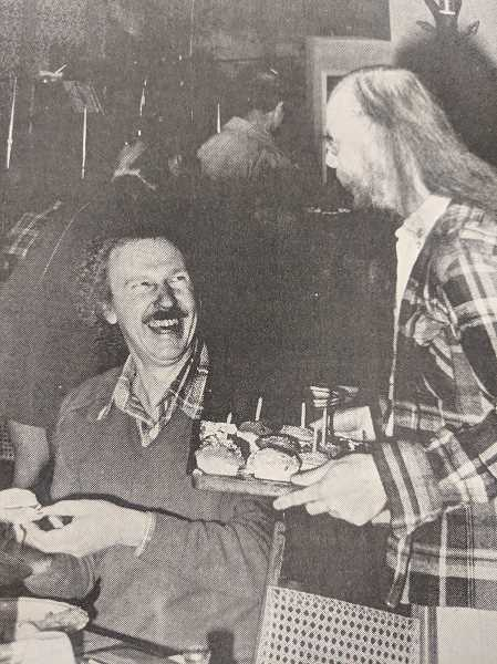 ARCHIVE PHOTO - City Manager John Rowley recieves a birthday cupcake in celebration of Estacada's 75th anniversary from Clackamas County News typesetter Marvin Moore in 1979.