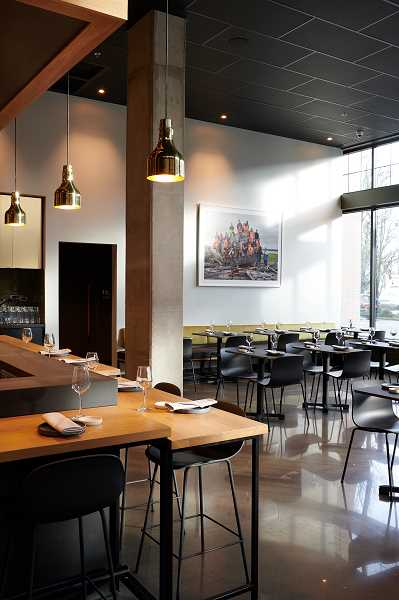 DINA AVILA/FOR THE REVIEW - Sustainable materials were key to the design of Bamboo Sushi's Lake Oswego space, which features warm wood tones, live greenery, soft seating and a signature art piece from Portland-based photographer Corey Arnold.