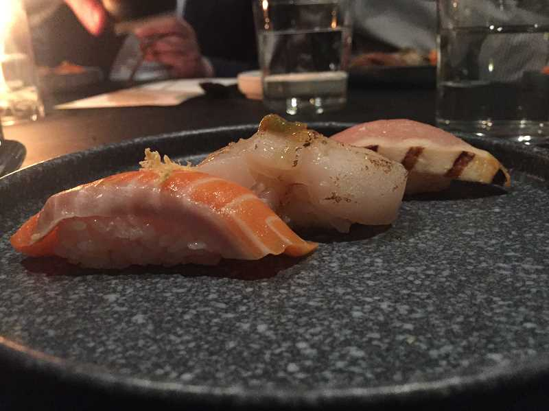 REVIEW PHOTO: ALICE STEIN - Among the courses on Monday's soft-opening menu: a delicate nigiri trio, featuring salmon, tuna and scallops.