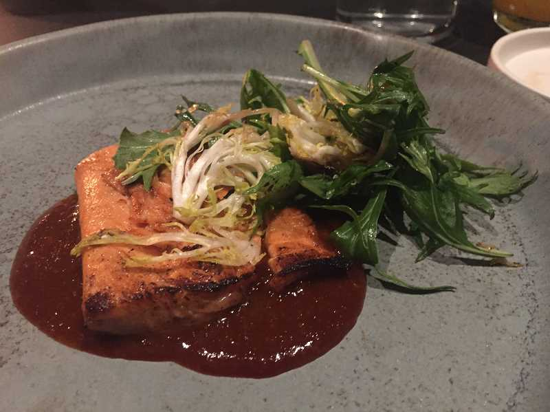 REVIEW PHOTO: ALICE STEIN - On the menu at Monday's soft opening: Pan-roasted Trout from McFarland Springs, one of the world's most sustainable aquaculture operations. The dish was served with grilled frisee, charred and pickled red onion and spicy fermented bean sauce.