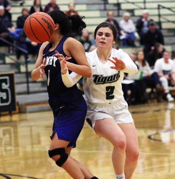 TIMES PHOTO: DAN BROOD - Tigard High School junior Kennedy Brown (right) battles Canbys Naaral Gomez for a loose ball during the Tigers win on Tuesday.