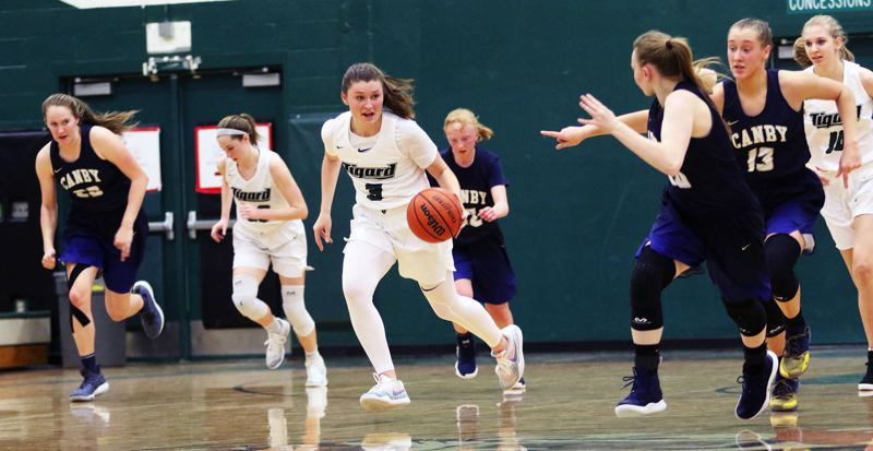 TIMES PHOTO: DAN BROOD - Tigard High School senior Campbell Gray (3) leads a fast break after coming up with a steal during the Tigers win over Canby.