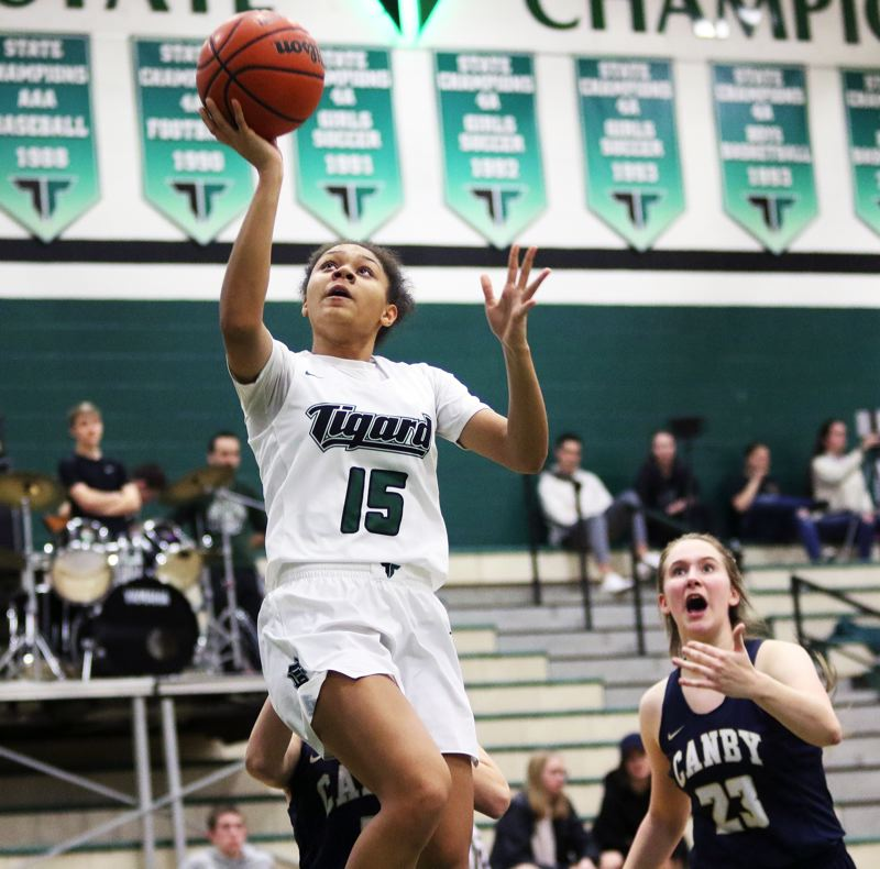 TIMES PHOTO: DAN BROOD - Tigard High School sophomore Ajae Holdman goes up to the basket during the Tigers Three Rivers League win over Canby on Tuesday.