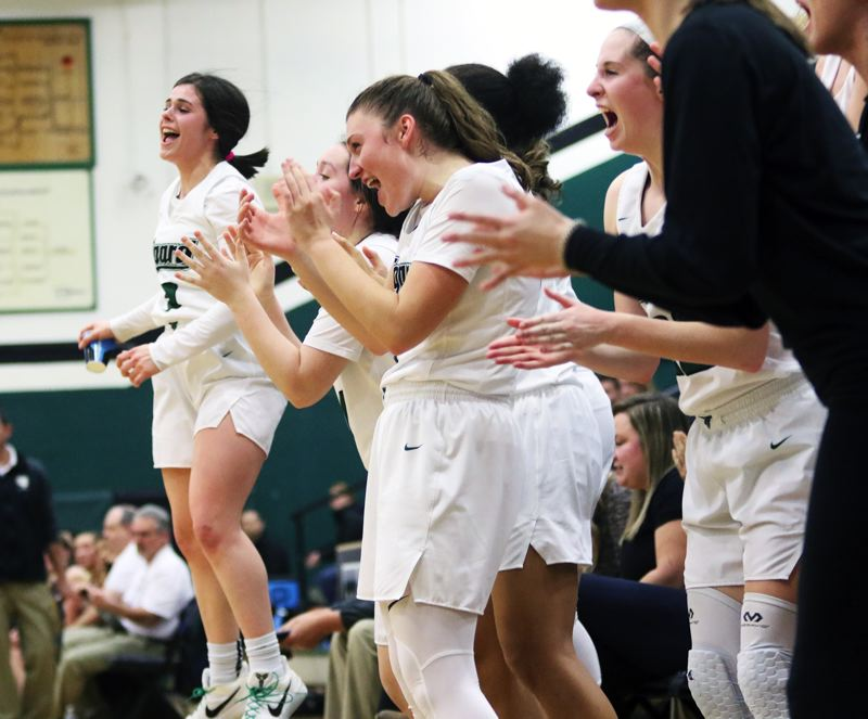 TIMES PHOTO: DAN BROOD - Tigard players, including Kennedy Brown (left) cheer following a late Tiger basket during the team's 59-39 win over Canby on Tuesday.