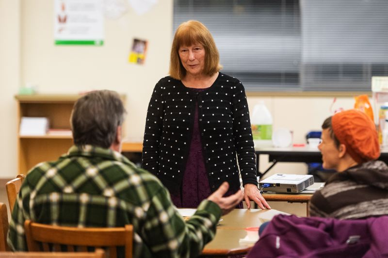 STAFF PHOTO: CHRISTOPHER OERTELL - State Rep. Susan McLain, D-Forest Grove, listens to a constituent at a public meeting in the Free Orchards Elementary School library on Tuesday, Jan. 8.