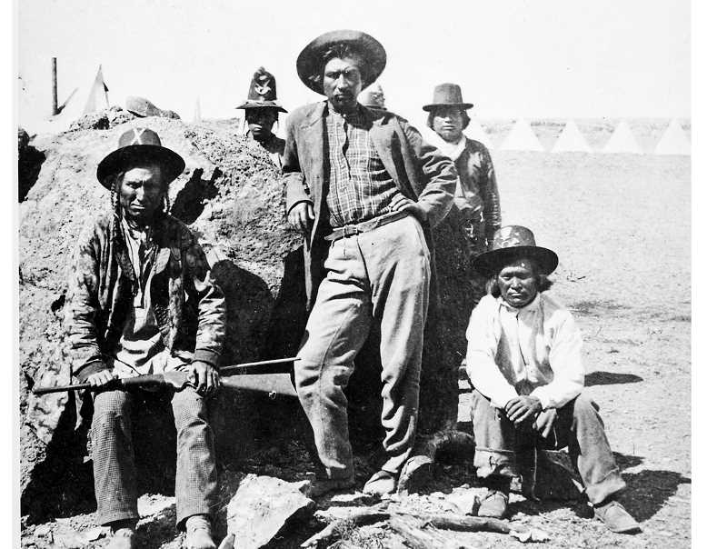 PHOTO COURTESY U.S. WAR DEPARTMENT - Warm Springs Indian Scouts in the field at the scene of the Modoc War, in 1873, pose for a photograph. Their leader, Capt. Donald McKay, is the man standing in the front.