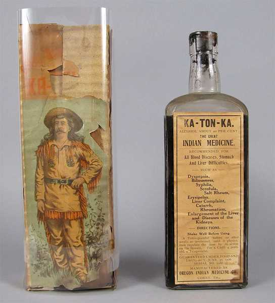 PHOTO COURTESY SMITHSONIAN - A bottle of Ka-Ton-Ka, with the box that it came in (in a protective plastic sleeve). The mountain man in fringed buckskins is Donald McKay.