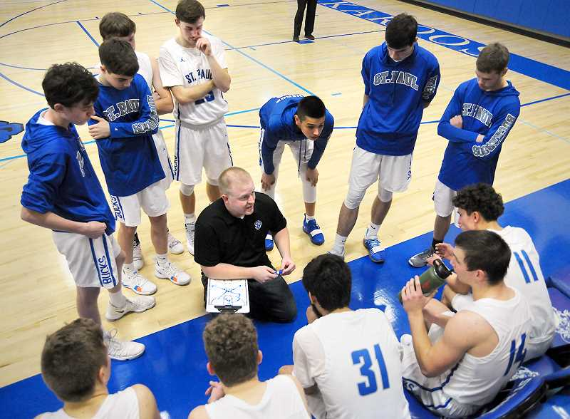 GARY ALLEN - St. Paul coach Todd Swan strategizes with his players in the final moments of hte Bucks' 51-48 win over the Watchmen Tuesday at home.
