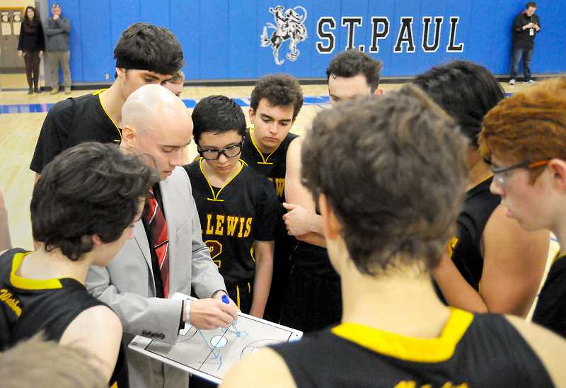 GARY ALLEN - C.S. Lewis coach Brett Vernon draws up a play in the Watchmen's loss to St. Paul Tuesday in a key Casco League match-up.