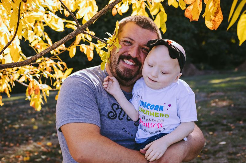 COURTESY PHOTO: HP STUDIOS HAYES PETERSON - Kailanie Dykes, pictured with her father Jon Dykes, has both lateral meningocele syndrome and acute lymphoblastic leukemia. She will receive support from students at South Meadows Middle School through the Sparrow Clubs.