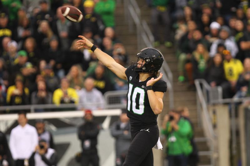 TRIBUNE PHOTO: JAIME VALDEZ - Justin Herbert has bolstered the Oregon offense with his plans to return for a senior season.