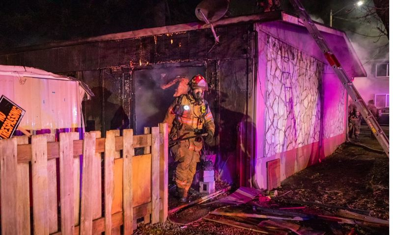 COURTESY PHOTO: GREG MUHR/PF&R - One woman died early Wednesday morning, Jan. 9, in a fire that destroyed a four-plex in Northeast Portland.
