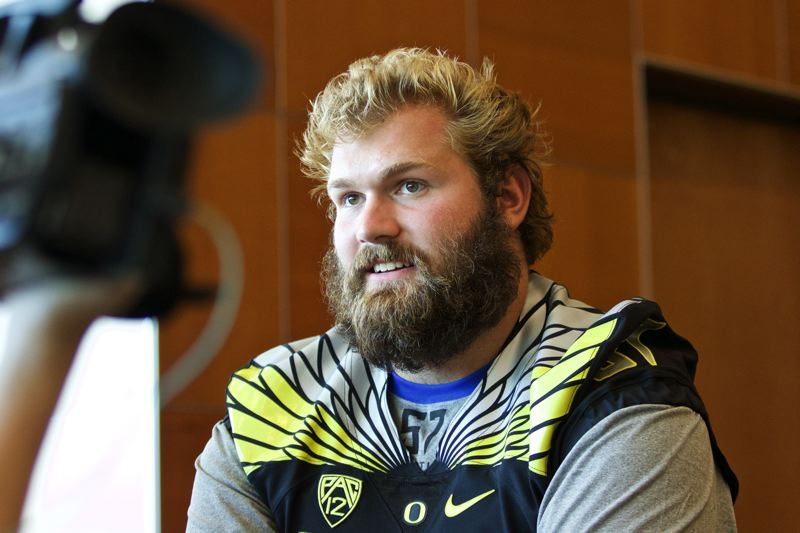 PAMPLIN MEDIA GROUP FILE PHOTO - Oregon Ducks lineman Doug Brenner (57) spoke to reporters during one of the university's media days. Brenner is suing the university, the NCAA and former head coach Willie Taggart for more than $11 million.