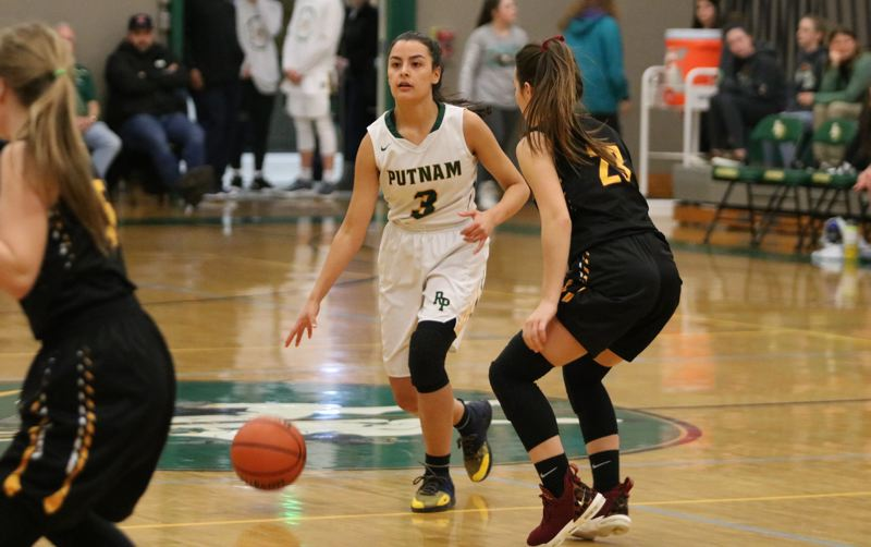 PAMPLIN MEDIA: JIM BESEDA - Putnam's Miranda Evans (3) scored 17 of her game-high 26 points in the third quarter of Tuesday's Northwest Oregon Conference opener against cross-town rival Milwaukie.