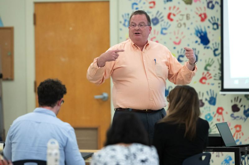 TRIBUNE FILE PHOTO - Pat Allen, director of the Oregon Health Authority, spoke last year at Madison High School about the future of the program that provides care to 1 million Oregonians, the Oregon Health Plan.
