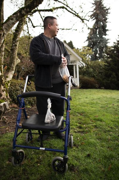 TRIBUNE PHOTO: JAIME VALDEZ - Sam Pham, 44, is one of the 1 million people who rely on the Oregon Health Plan. The unemployed graphic designer uses a walker and cane to deal with spine and nerve issues. His condition has gotten worse since 2015, but he is facing a four-month wait to see a neurologist.