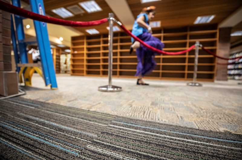 REVIEW PHOTO: JONATHAN HOUSE - Part of the renovation of the Lake Oswego Public Library's main floor will involve the installation of new carpet (foreground).