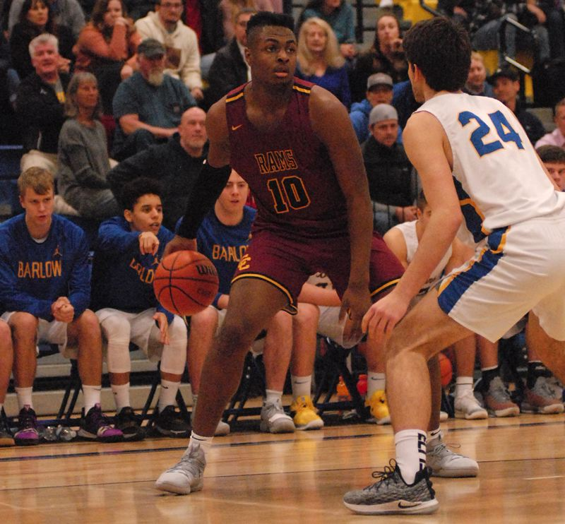 OUTLOOK PHOTO: DAVID BALL - Central Catholics SataieVior Ayilola looks to make a move on the perimeter. He finished with a game-high 33 points.