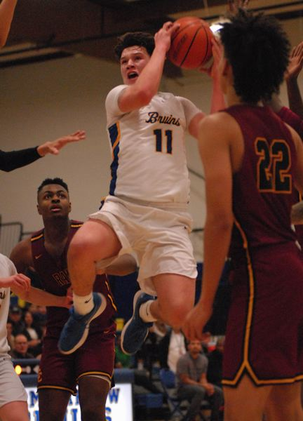 OUTLOOK PHOTO: DAVID BALL - Barlows Dominic Jacoby soars through traffic on his way to the basket during the Bruins 85-82 loss to Central Catholic on Tuesday.