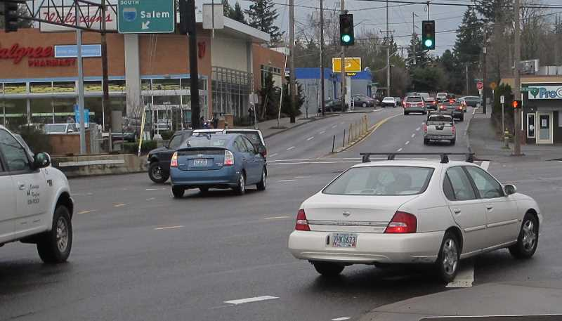 (Image is Clickable Link) This photo was taken looking northbound on Capitol Highway towards Walgreens.  The left-hand turn being taken by the Prius and pick-up truck would be prohibited under ODOT's plan