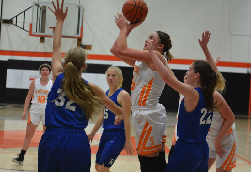 PAMPLIN MEDIA GROUP PHOTO: MATT SINGLEDECKER - Scappoose junior post Gaby Dague takes a shot en route to her team-high 12 points against Hillsboro on Tuesday.