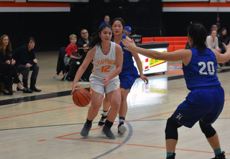 TIMES PHOTO: MATT SINGLEDECKER - Scappoose junior wing Allison Wills makes her way to the basket against Hillsboro.
