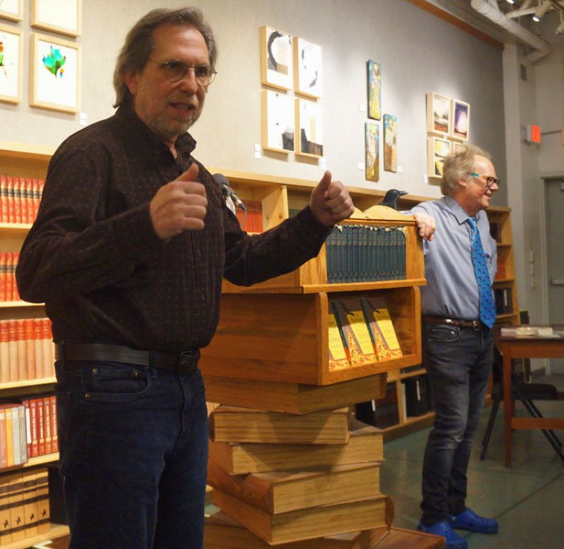 PHOTO: FOREST AVENUE PRESS - Dan Rhiger, left, an audio engineer at Medicine Whistle Studio, leads the crowd in song as author Stevan Allred looks on.
