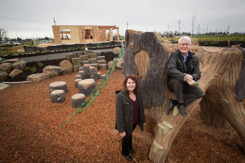PAMPLIN MEDIA GROUP: JAIME VALDEZ - Kelly Ritz, president of home builder Stone Bridge Homes NW, and David Brentlinger of developer Newland, on the play structure at the Greenway at Reeds Crossing. The proposed South Hillsboro build out of 8,000 new homes will be the largest planned housing development in Oregon history.