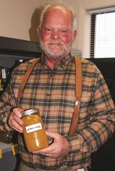 HOLLY SCHOLZ/CENTRAL OREGONIAN  - MC Farmer LLC owner Mike Cowan shows a bottle of CBD in a crystallized form.