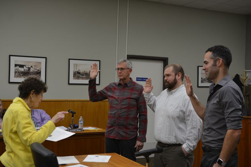 SPOTLIGHT PHOTO: COURTNEY VAUGHN - Columbia County Clerk Betty Huser administers the oath of office to Scappoose City Councilors Joel Haugen, Brandon Lesowske and Joshua Poling prior to a council meeting Monday, Jan. 7. Monday marked Lesowske's first term on the council.