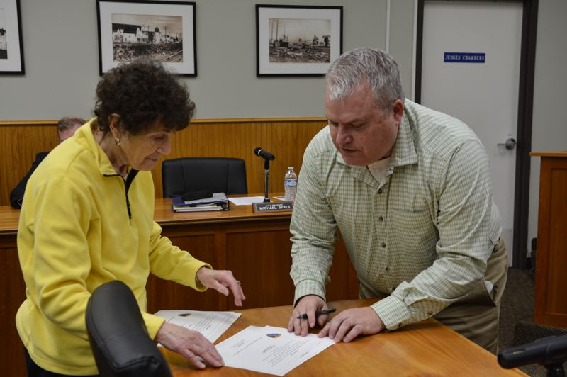SPOTLIGHT PHOTO: COURTNEY VAUGHN - Scappoose Mayor Scott Burge is sworn in for another term by County Clerk Betty Huser.