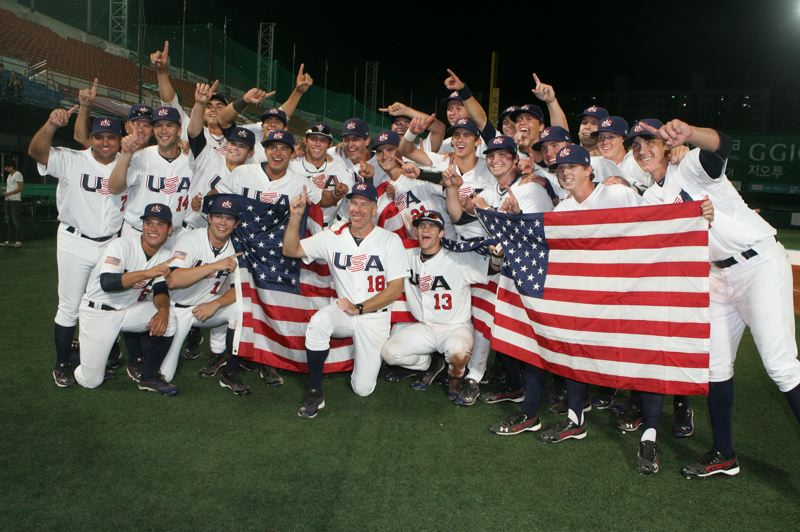 COURTESY: USA BASEBALL - Scott Brosius (18) celebrates with the U-18 team he led to the 2012 World Cup championship for USA Baseball. Now he's the organization's new senior director of player development.