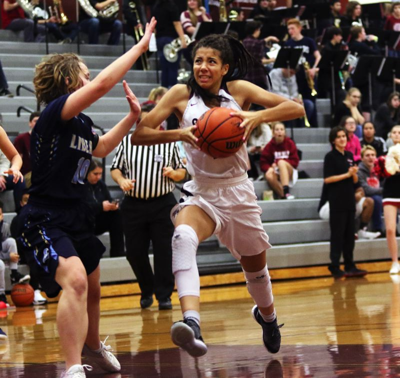 TIMES PHOTO: DAN BROOD - Sherwood sophomore Kylah Williams drives to the hoop during the Lady Bowmen's win over Liberty.