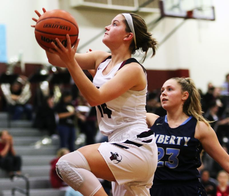 TIMES PHOTO: DAN BROOD - Sherwood senior Alex Verkamp goes up to the basket during the Lady Bowmen's win over Liberty.