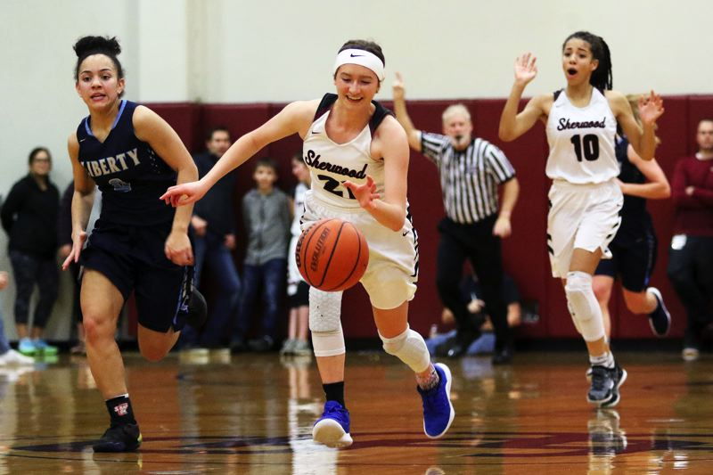 TIMES PHOTO: DAN BROOD - Sherwood junior Ava Boughey leads a fast break during the Lady Bowmen's win over Liberty.
