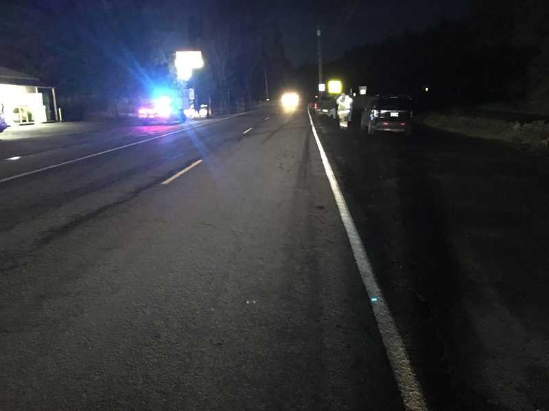 PHOTO COURTESY OF COLUMBIA COUNTY SHERIFF'S OFFICE - Emergency crews investigate a crash at Scappoose Vernonia Highway near Wikstrom Road that sent a man to the hospital with life-threatening injuries Friday, Jan. 11.