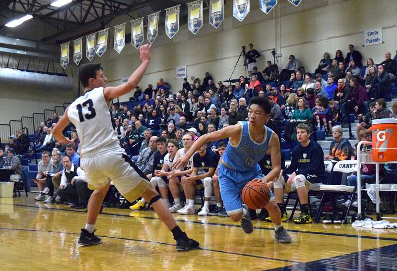 HERALD PHOTO: TANNER RUSS - Lakeridge senior Lawrence Chen had 10 points against Canby in the teams' rematch, and was 50 percent from the field.