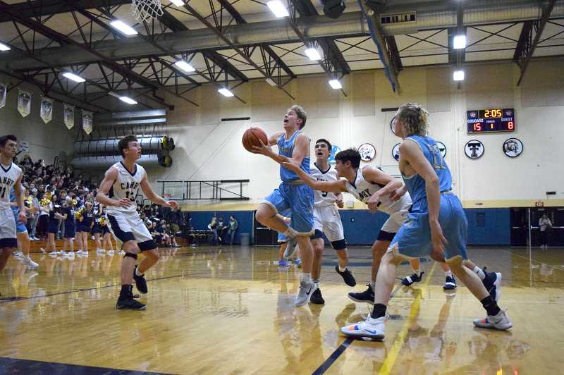 HERALD PHOTO: TANNER RUSS - Lakeridge's Charlie Maynes drives to the basket against Canby.