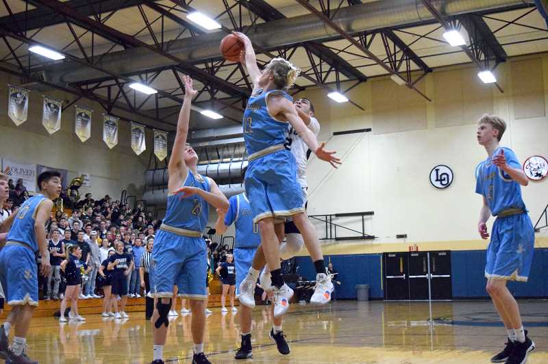 HERALD PHOTO: TANNER RUSS - Lakeridge senior Noa Bothe blocks Canby junior Ronan Gay. Bothe led the Pacers with 17 points and was 89 percent from the field. Canby defeated Lakeridge 64-58 in the rematch.