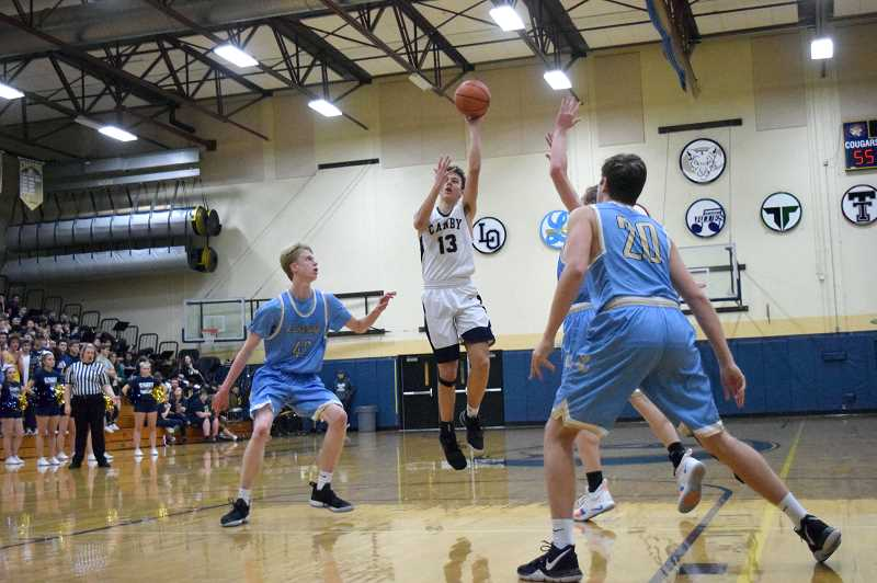 HERALD PHOTO: TANNER RUSS - Canby sophomore Ben Bailey had 16 points in the rematch with Lakeridge, making half of his points from the paint, the other half from the free throw line.