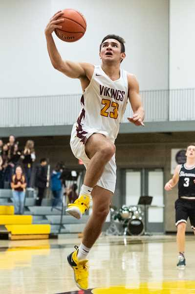 STAFF PHOTO: CHRISTOPHER OERTELL - Forest Grove's Guy Littlefied goes up for a lay in during the Vikings game against Sherwood, Friday, Jan. 11, at Forest Grove High School.