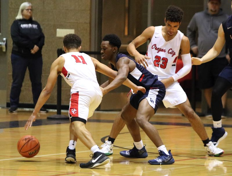 PAMPLIN MEDIA: JIM BESEDA - Oregon City's Erich Nova (23) sets a screen as Andre Best (11) tries to shake loose from Lake Oswego defender Wayne McKinney during the first quarter of Friday's Three Rivers League game.
