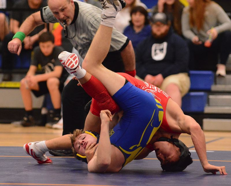 OUTLOOK PHOTO: DAVID BALL - Centennials Phillip Kue gets a good look at his opponents shoulders on his way to a fall at 138 pounds.