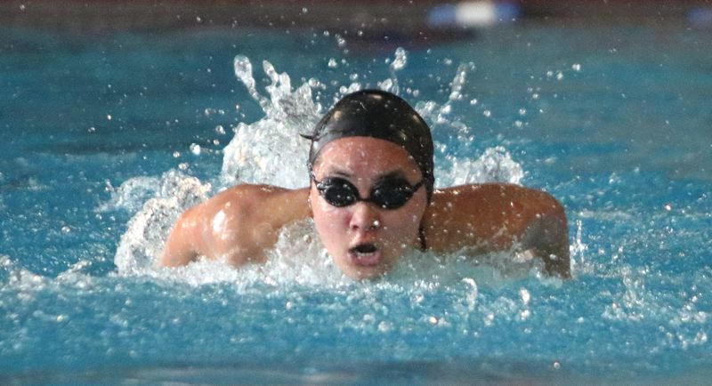 PAMPLIN MEDIA: JIM BESEDA - Oregon City freshman Michelle Vu won the girls' 100 butterfly in 1 minute, 6.68 seconds during Thursday's Three Rivers League swim meet against Lake Oswego at the Oregon City Pool.