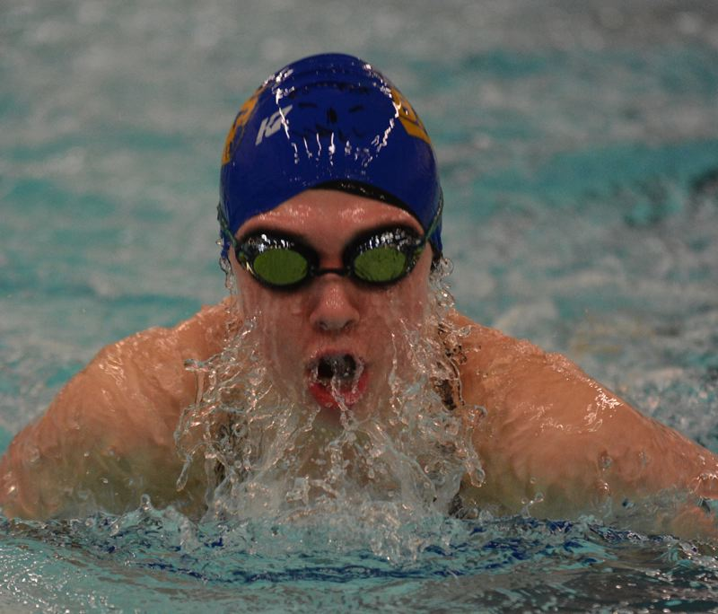 OUTLOOK PHOTO: DAVID BALL - Barlows Madison Kernan breaks through the surface on her way to a win in the breaststroke during Thursdays dual against Gresham.